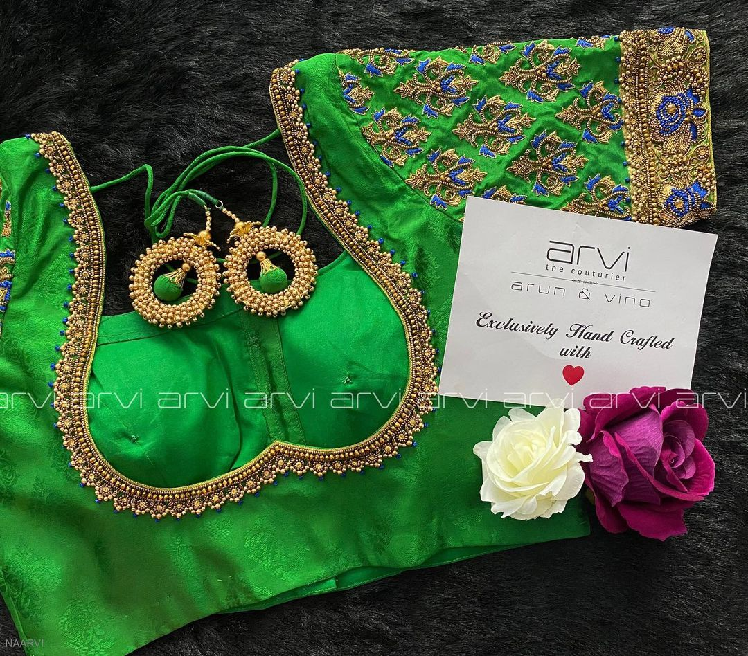 Gorgeous parrot green color blouse design with bead aari work.  2021-05-15