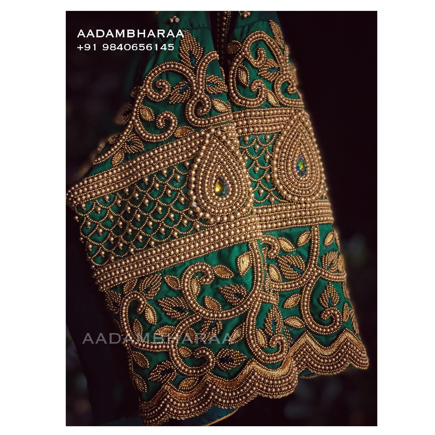 Gorgeous bottle green color blouse design with floral bead aari work on sleeves. 2021-05-16