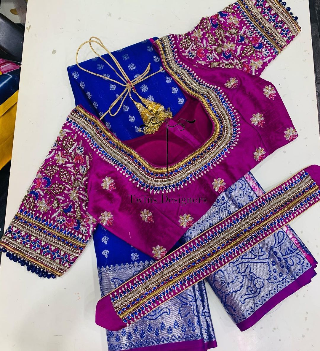 Stunning blue color designer blouse for kanchi pattu saree with floral design hand embroidery classy maggam work.  2021-05-16