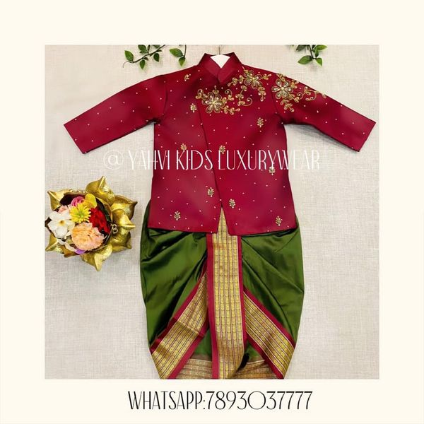 Deep and rich maroon  kids sherwani in hand embroidery work paired with soft silk moss green dothi . For orders : DM or whatsapp 7893037777( messages only  no calls plz )  2021-05-17