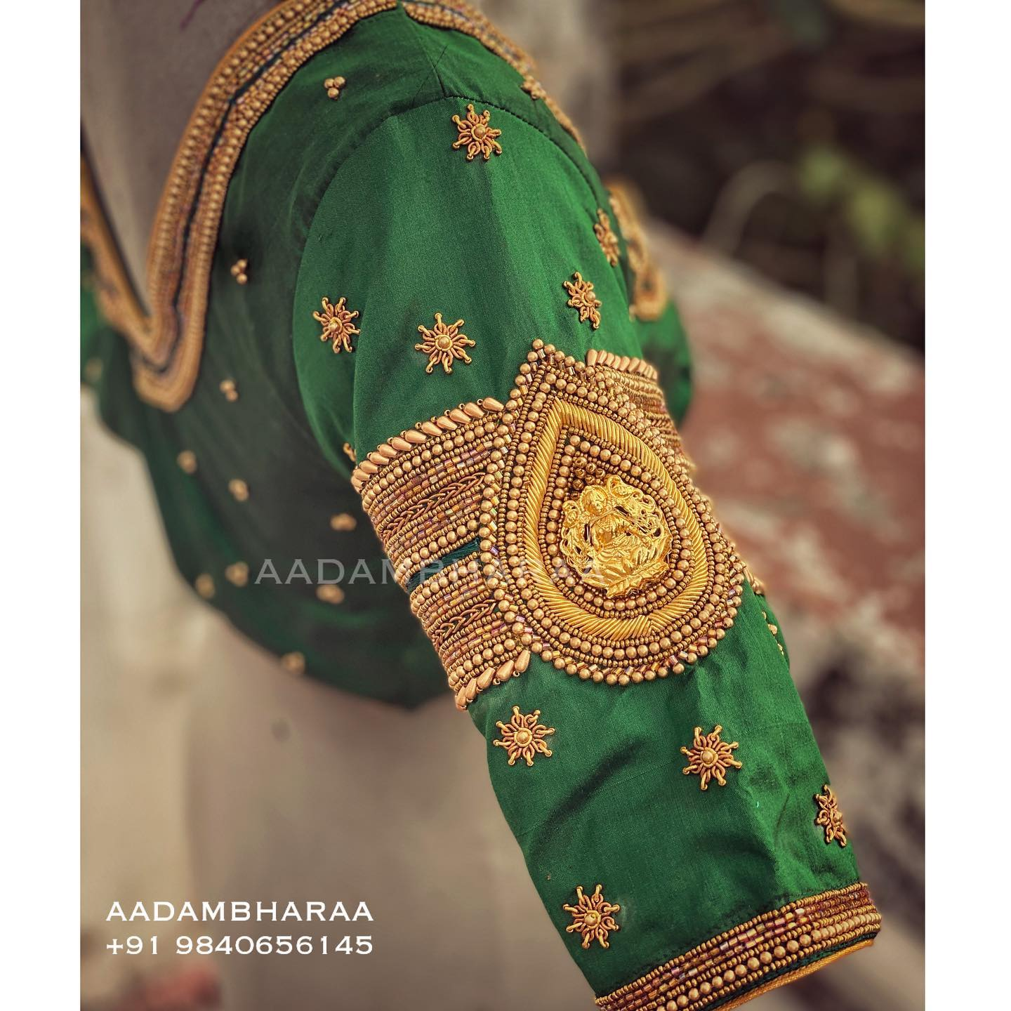 Green Bridal blouse. Stunning green color blouse with Lakshmi vanki design hand embroidery  gold thread and bead aari work on sleeves. 2021-05-17