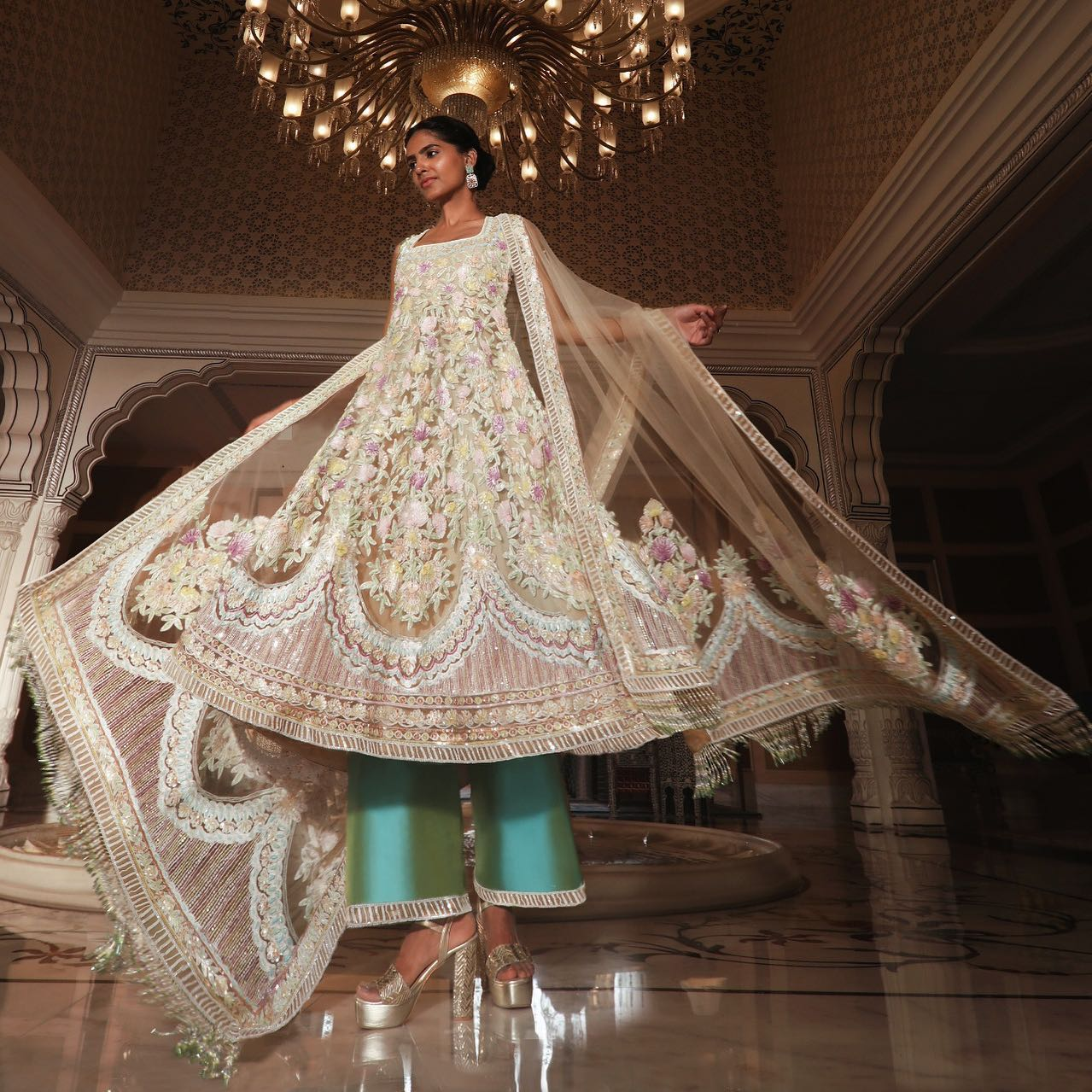 The departure of spring marks the cloudburst of delicate pastel-hued sequins and crystals sprinkling on Biscotti flared Tunic in Kashmiri embroidery accompanied by tasselled drape and aqua teal silk palazzos enticing the softness and tranquillity of a #Nooraniyat soiree.  2021-05-17