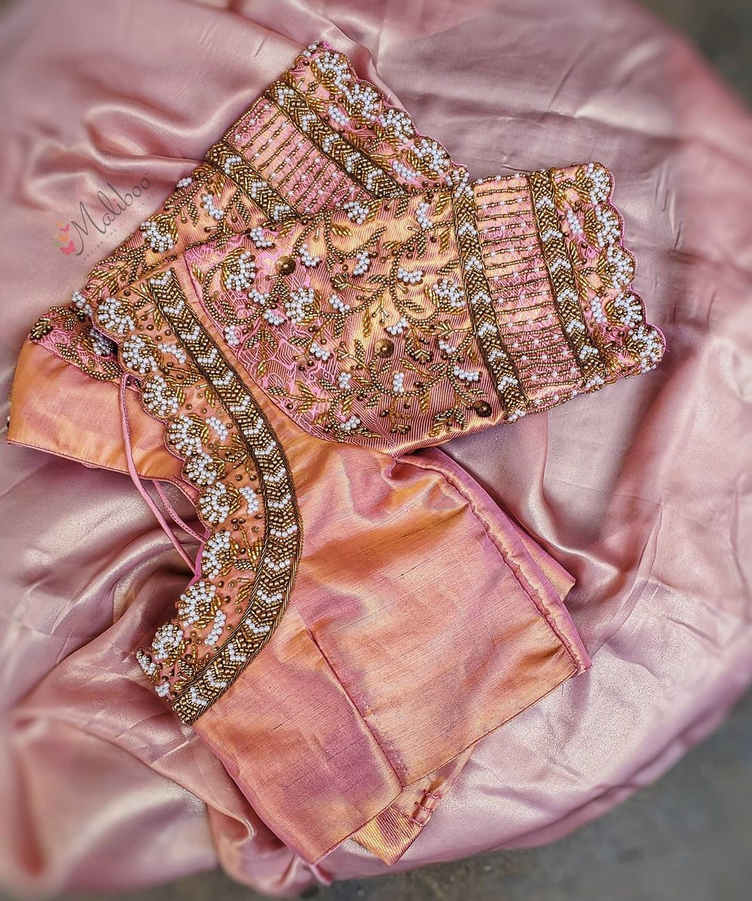 A beautiful rare combo of peach and pink embellished with pearls aari work blouse. 2021-05-17