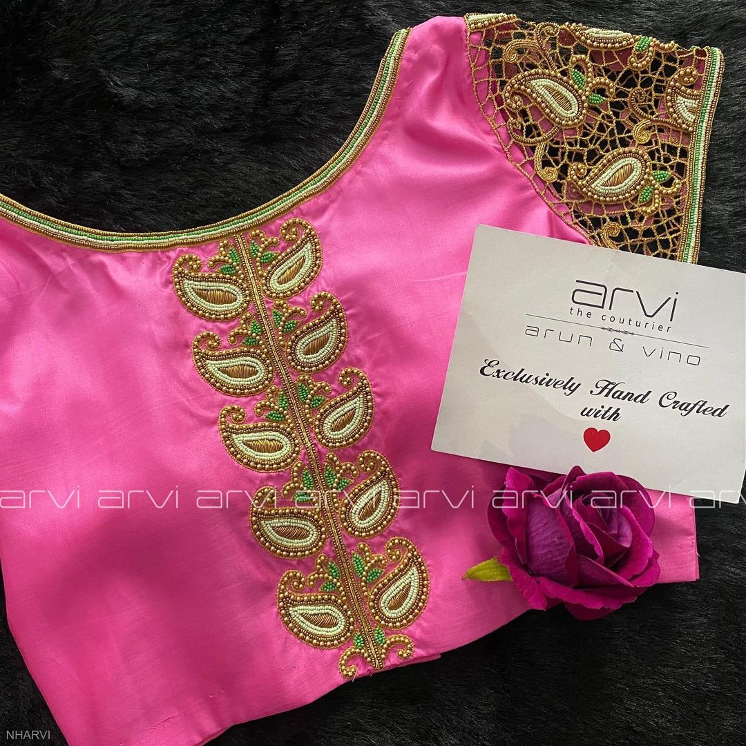 Gorgeous blush pink color boat neck blouse with mango design bead aari work. Blouse with cut work embroidery  sleeves. 2021-05-17