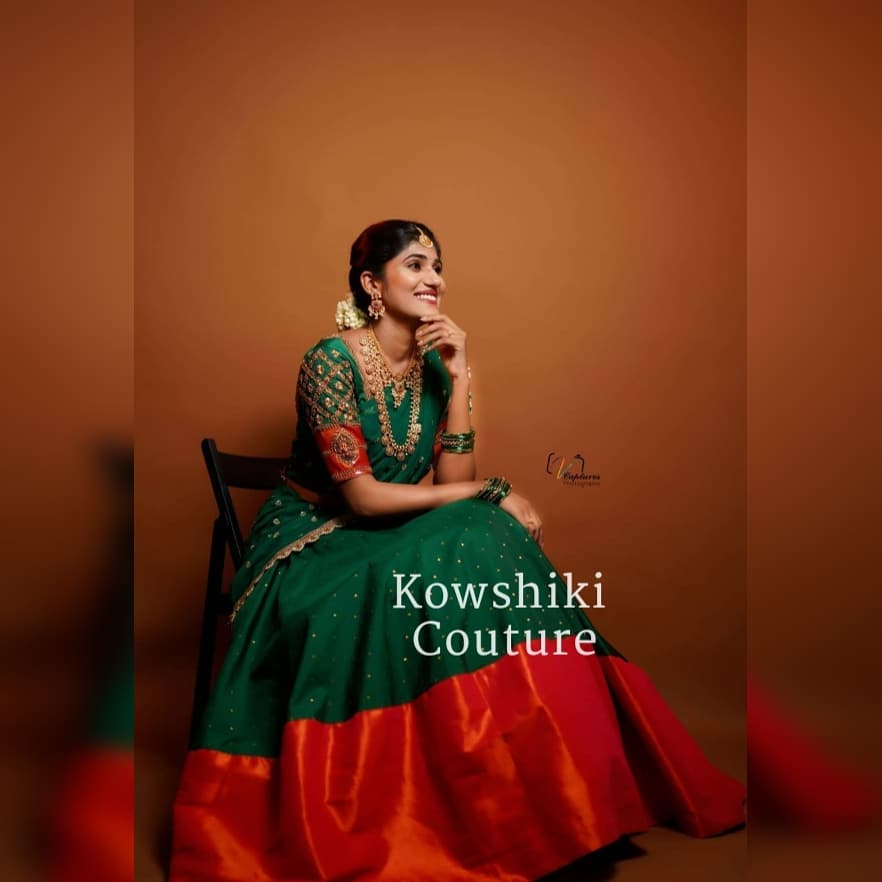 Stunning bottle green and red color combination pattu lanaga and blouse with net dupatta. 2021-05-17