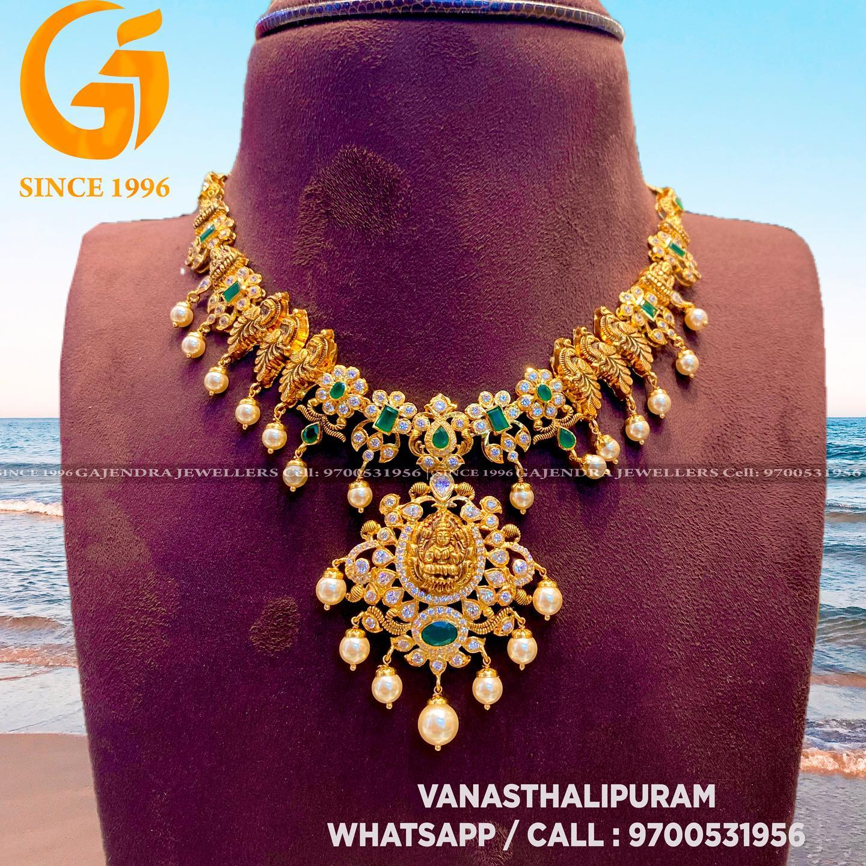 Stunning 22k gold nakshi work peacock motifs necklace with Lakshmi devi pendant. 2021-05-18