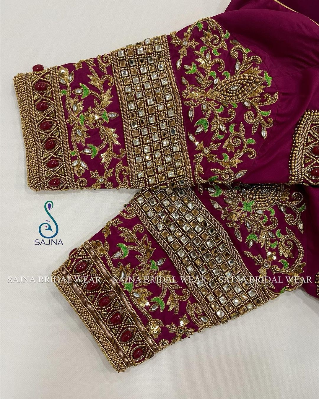 Gorgeous purple color blouse sleeve design with floral creeper hand embroidery bead and stone aari work.  2021-05-18