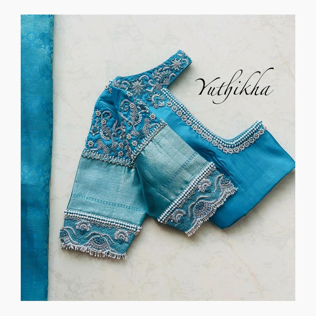 Lovely sky blue color bridal blouse with silver thread and bead maggam work. 2021-05-18