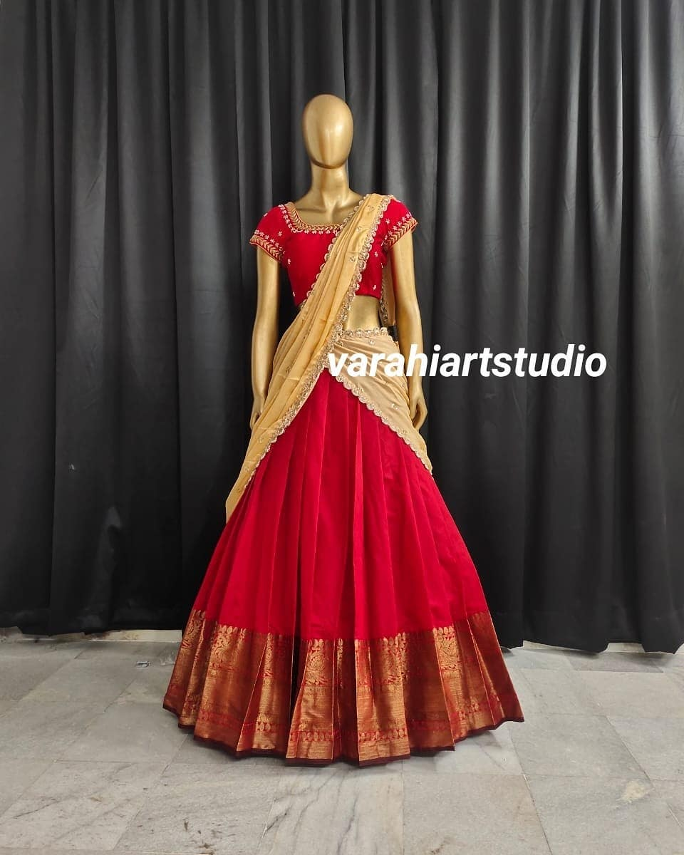 Beautiful red and cream color combination simple pattu langa voni. Blouse with hand embroidery work.  2021-05-18