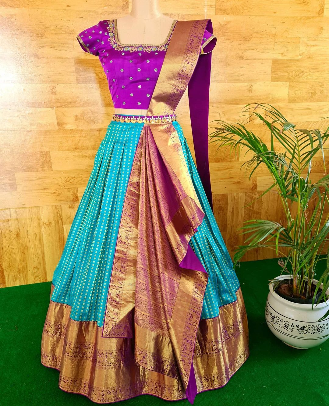 Redefine occasion wear with this Pre draped and stitched duppata on a crop top and skirt. Beautiful powder blue and purple color combination pattu langa voni.  2021-05-18