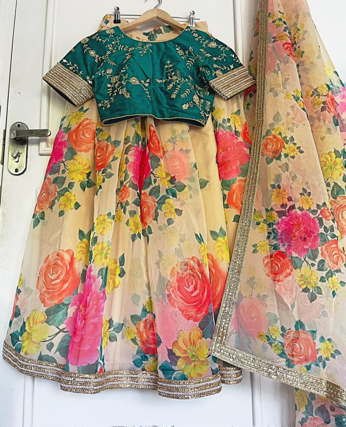 FLORAL ORGANZA. <br> Floral organza lehenga or sari. Beautiful floral print on an ivory base.   Gorgeous borders and a hand embroidered blouse on a raw silk base.  2021-05-19