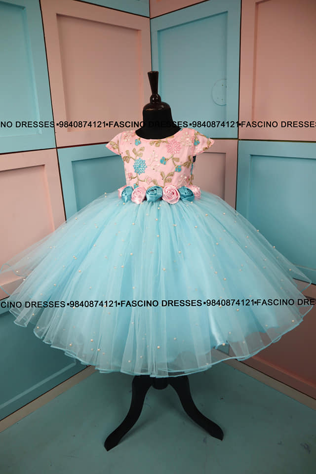 An elegant pink with blue pearl kids gown from Fascino. Wats app or inbox to order 9840874121 Can customize in any color/ size . 2021-05-20