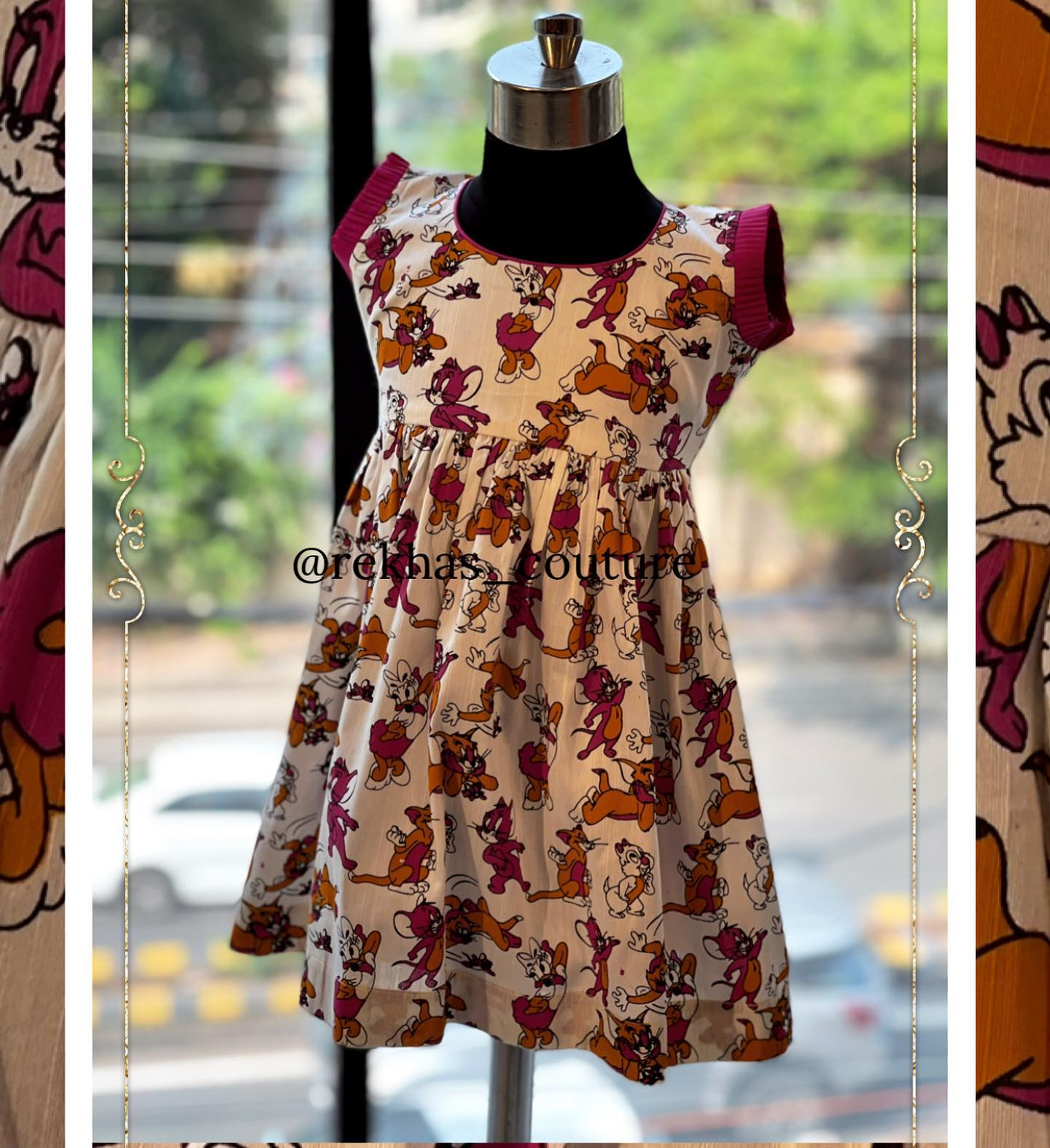 Beautiful tom and jerry print kids frock. 2021-05-20
