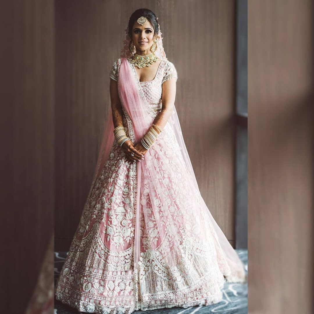 bespoke ornately embellished peony pink Kashmiri masterpiece adorned by Manish Malhotra Bride  is an outcome of the meticulous efforts of  skilled artisans. 2021-05-21