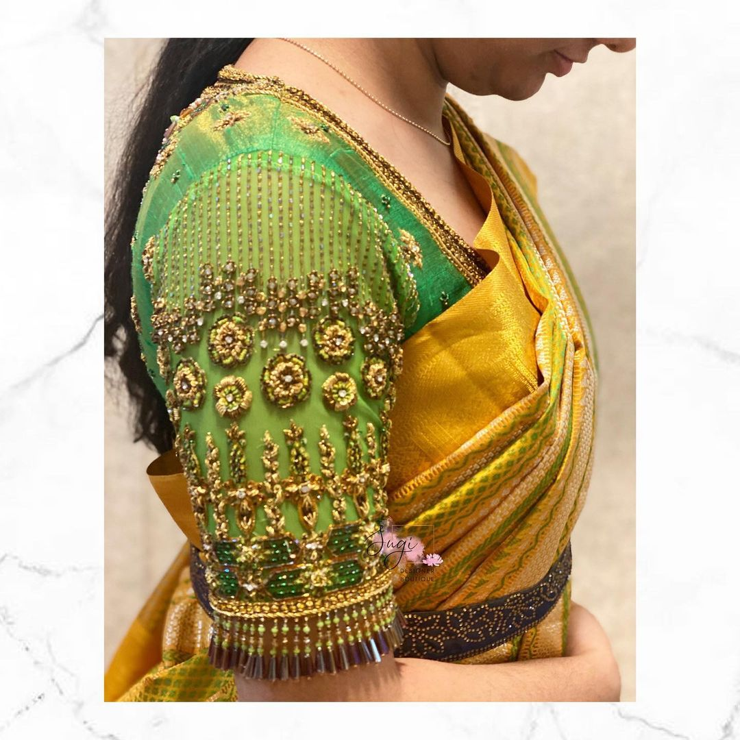 Gorgeous green color bridal blouse design with floral hand embroidery aari work.  2021-05-21
