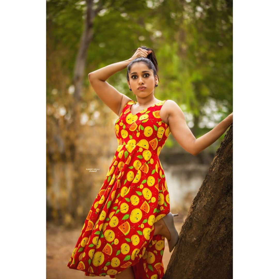 Stunning anchor Rashmi Gautham in watermelon print knee length dress. 2021-05-21