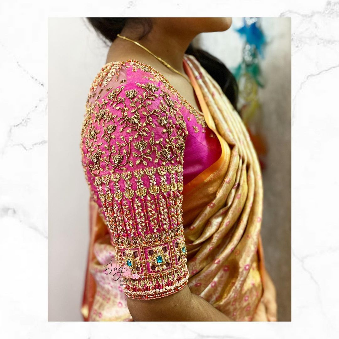 Stunning pink bridal blouse design with creeper hand embroidery bead and stone aari work.  2021-05-22