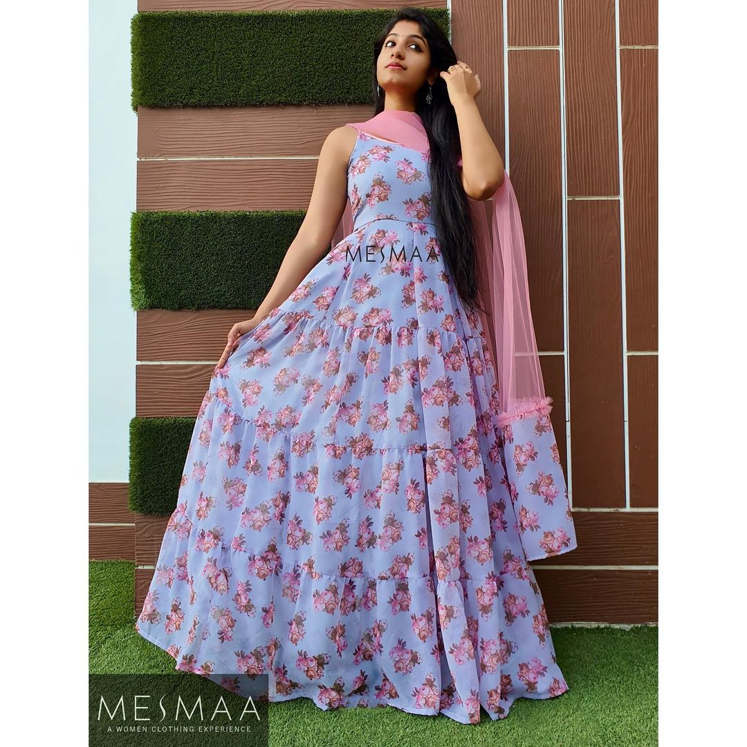 Beautiful ice blue color floral floor length dress with net dupatta.  2021-05-22