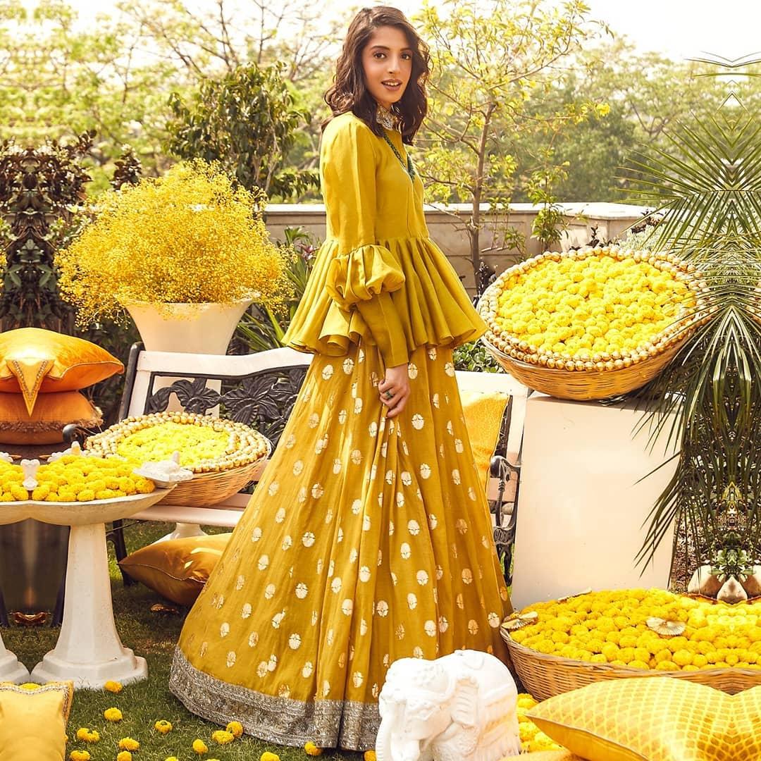 JayantiReddy X The Wedding Design Company. Stunning mustard yellow lehenga and peplum top. 2021-05-22
