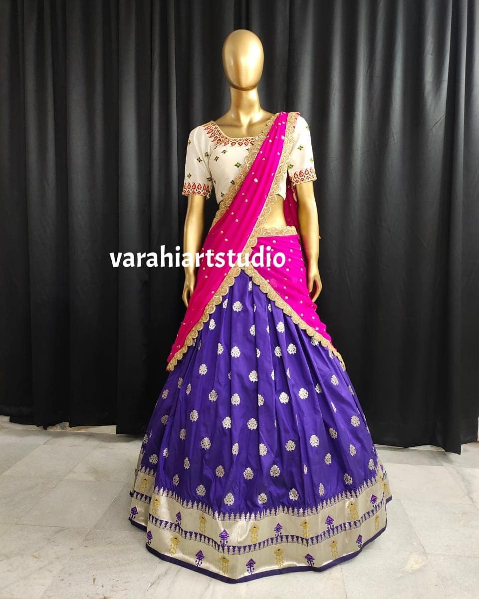 Stunning deep blue color silver pattu lehenga and off white color blouse with net dupatta. Blouse with hand embroidery work.  2021-05-23