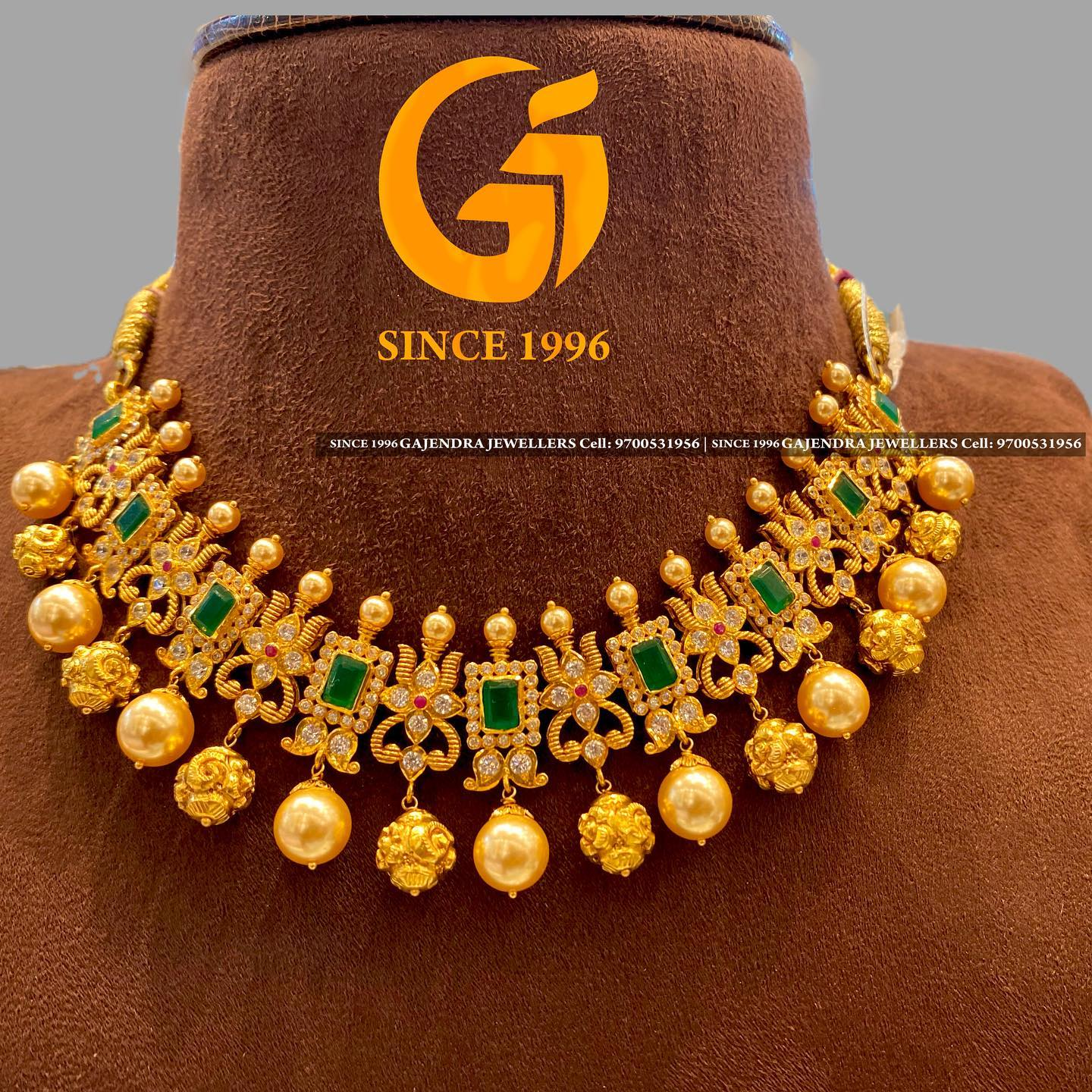 Stunning 22k gold necklace with south sea pearl and gold ball hangings.  2021-05-24