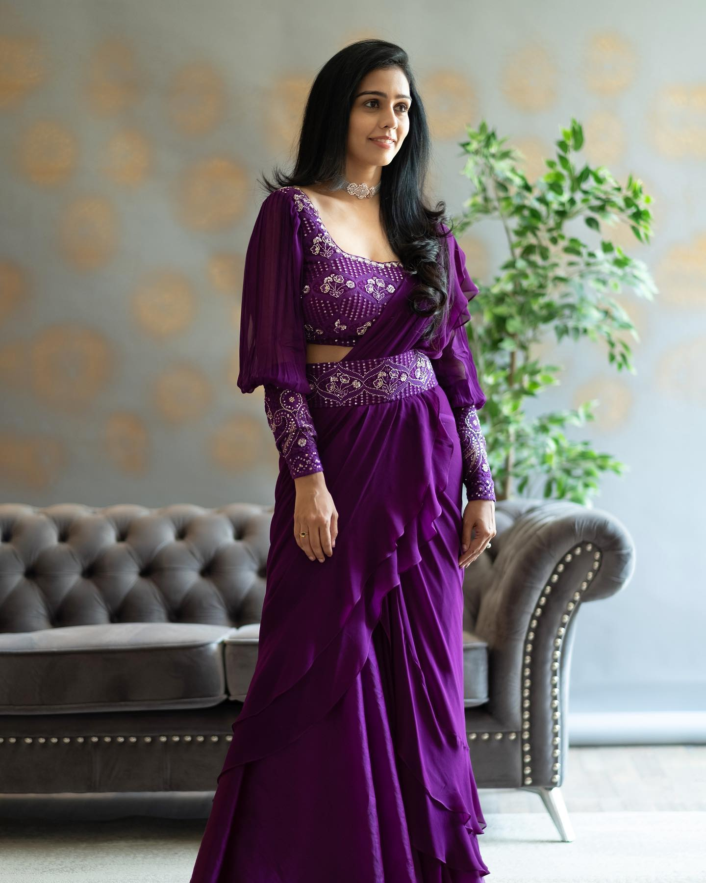 Stunning purple color ruffle saree and waist belt and full sleeve blouse. Blouse with hand embroidery work.   2021-05-24