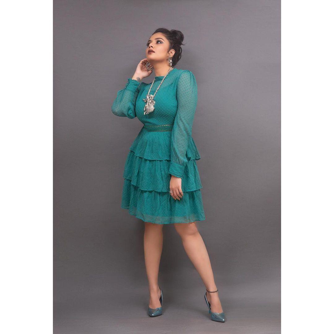 Beautiful actress Sreemukhi in sea green color knee length pleated dress. 2021-05-24