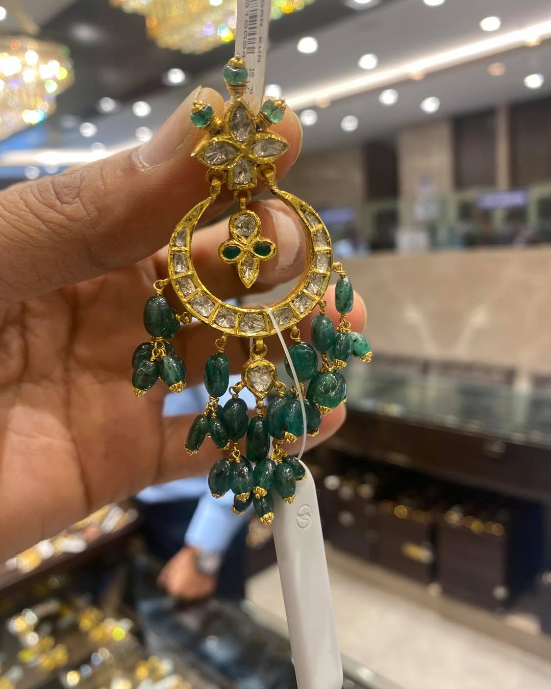 Gorgeous 22k gold chaandbalis studded with multi precious stones and emerald hangings.  2021-05-25