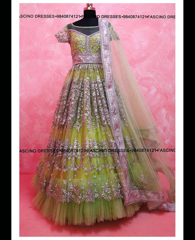 Here is a beautiful lime green with silver detailing bridal gown designed for a bride for her big day  A creation from Fascino . 2021-05-25