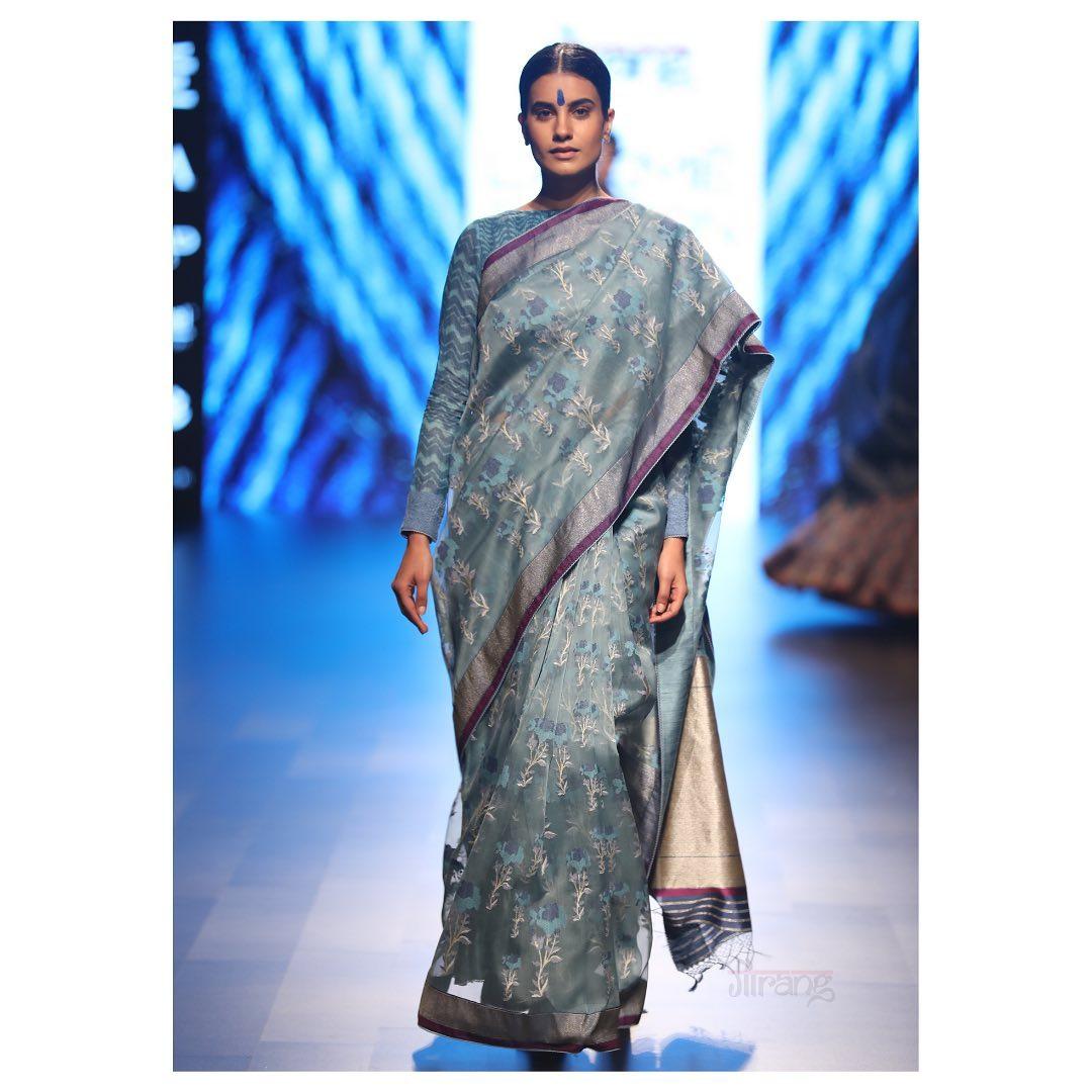 Elegant pale Indigo silk organza Jamdani Saree at the Lakme Fashion week.  2021-05-26
