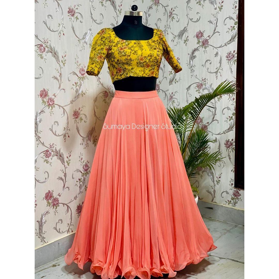 Beautiful peach skirt and yellow crop top with hand embroidery work.  Call  more details