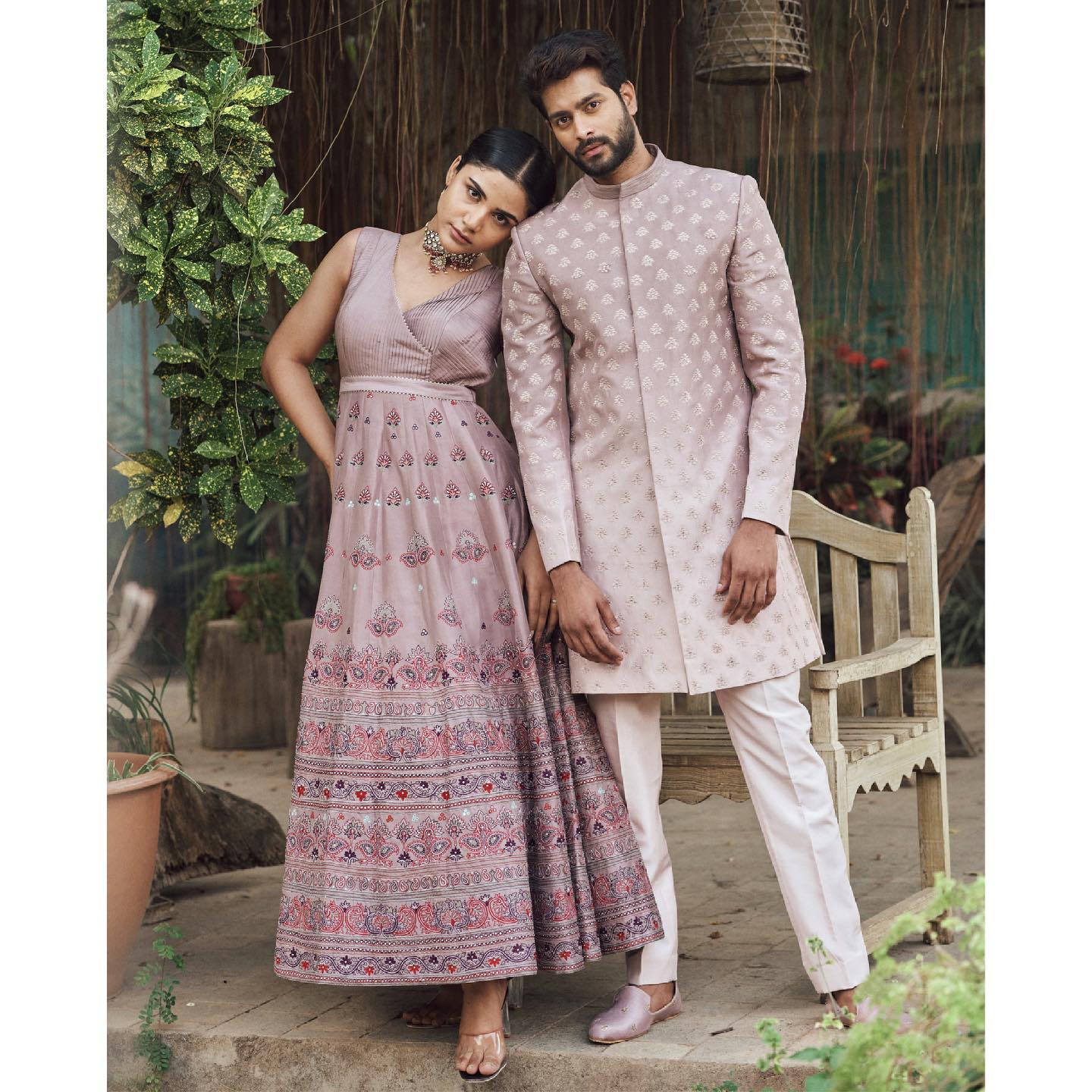 Phulwari . Raj seen in maple rose pink sherwani with all over self thread work buttis and a hint of silver detail to add to the richness of the look. Harshita seen in aari work gown with a pop of colour and some mirror work embroidery.  To shop our new collection Phulwari  DM us or Whatsapp us on +91 6302 878 533 2021-05-28