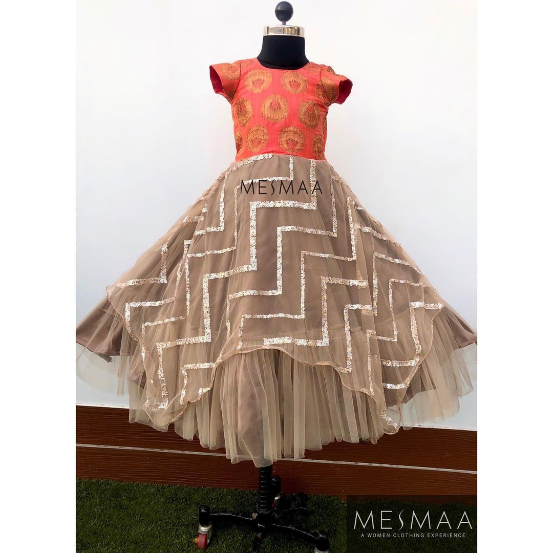 Some peach gowns for your little princess..! Ain't it too pretty to get your doll dolled up in this..?