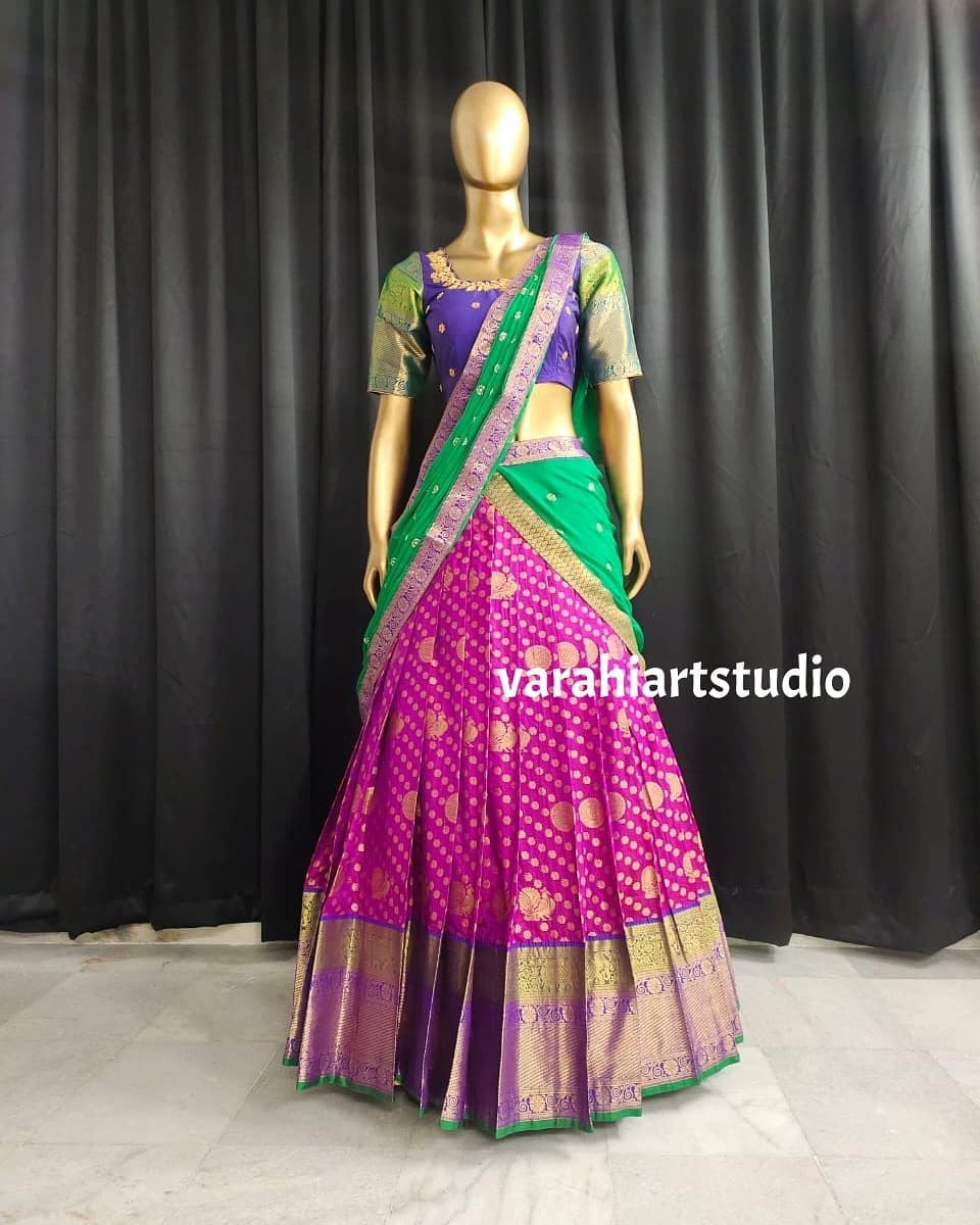 Stunning traditional purple and green color combination pattu langa voni. This outfit is Available at Rs 9800 from Varahi art studio .. 2021-05-29