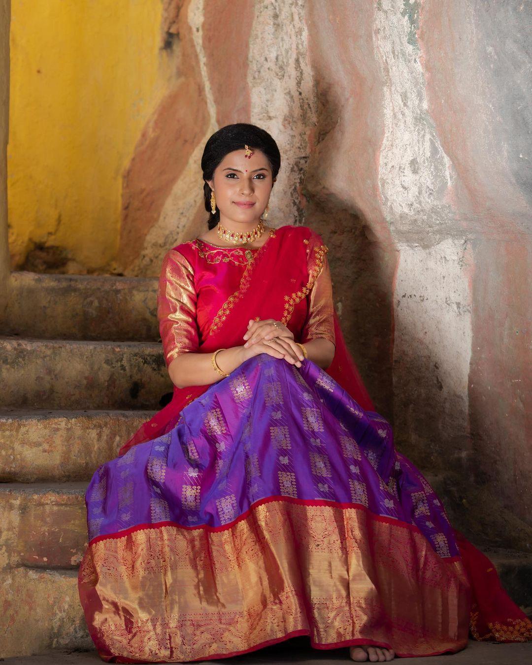 Traditional pattu langa voni.  The charming elegance of the purple hues   makes this beautiful Kanchipuram Silk Lehenga a mesmerising dream. 2021-05-29