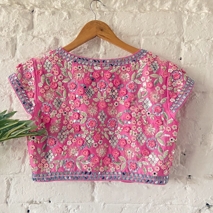 Stunning pink color boat neck blouse with classy hand embroidery work.  2021-05-30