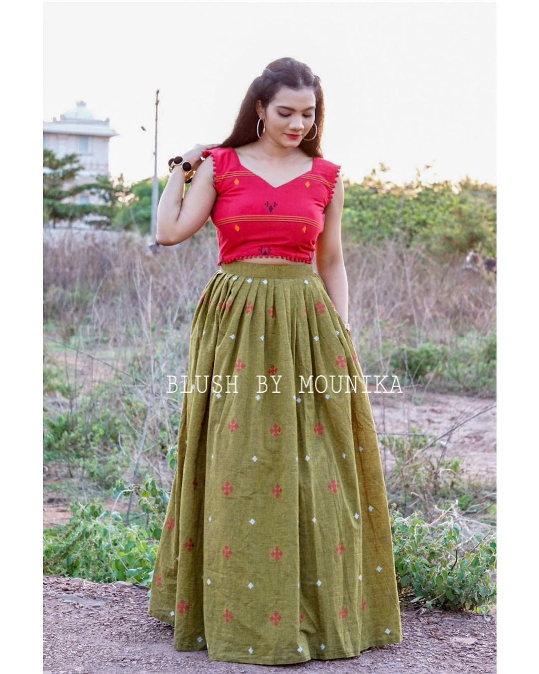 Varna. Price :  ₹3850.  Green handloom cotton skirt with buttis paired with red hand-loom cotton crop-top with back detailing.  2021-06-01