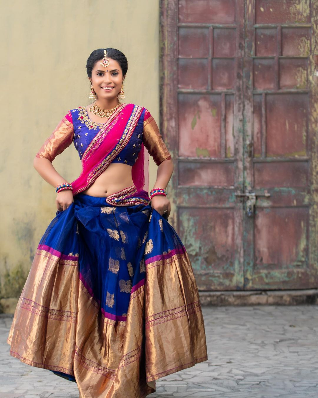 Traditional blue color pattu langa and blouse with net  dupatta. Pattu lehenga with big boarder. Blouse with jari sleeves. 2021-06-01