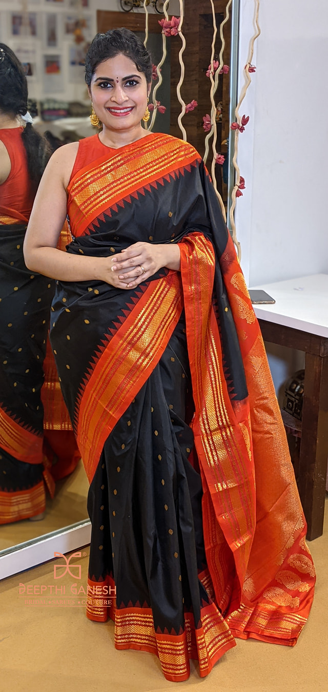 Traditional black and red color combination gadwal pattu saree. 2021-06-02