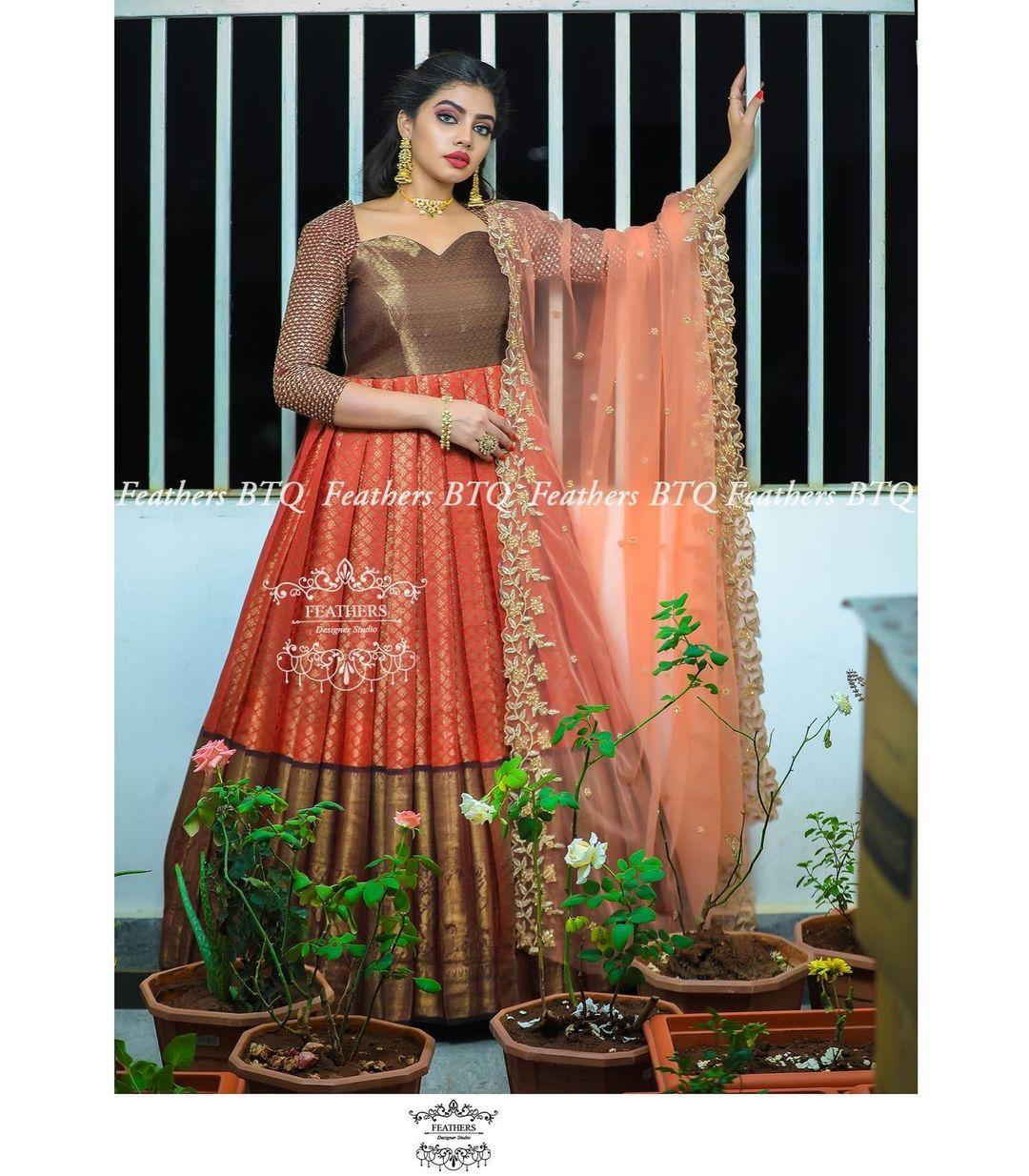 Stunning pattu long frock with big pattu border and jari sleeves and net dupatta. 2021-06-02