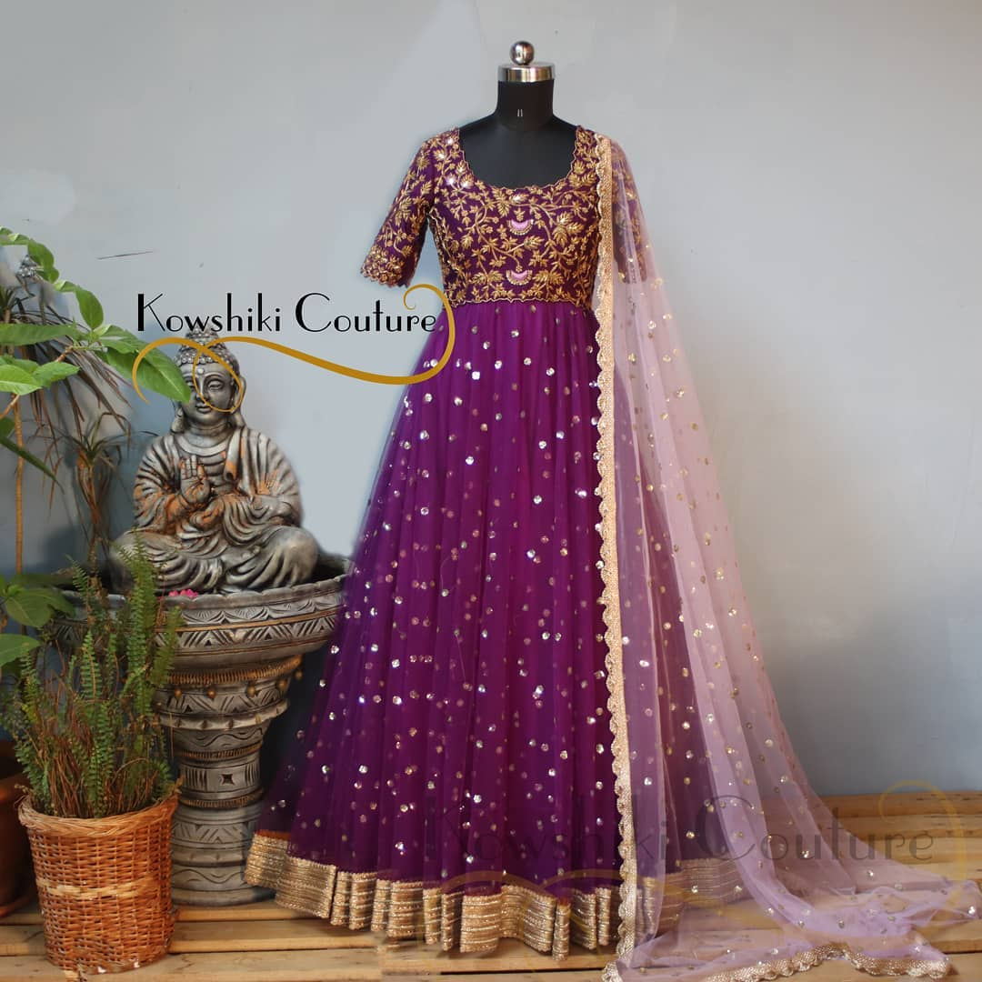 Make the heads turn when you dress up in this heavy yoke Long dress in dark Purple paired up with sheer net duppatta! 2021-06-03