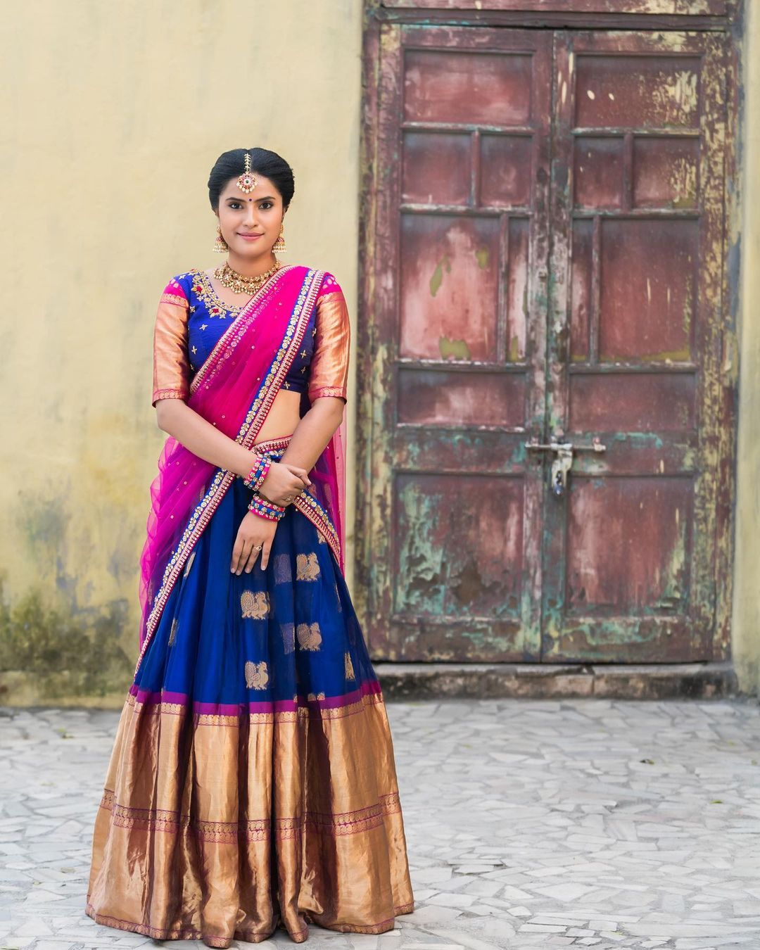 Stunning royal blue color kanchi pattu lehenga with swan motifs and big boarder. Blouse with pattu jari sleeves and hand embroidery work.  2021-06-03