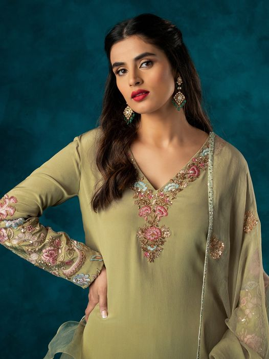 A classic muted olive crepe silk handcrafted kurta teamed with a churidar and dupatta. 2021-06-04