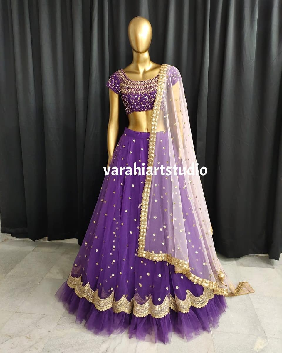 Gorgeous purple color net lehenga and blouse with net dupatta. This outfit is Available from Varahiartstudio .. They can customise the size as per your Measurements .. .. 2021-06-04