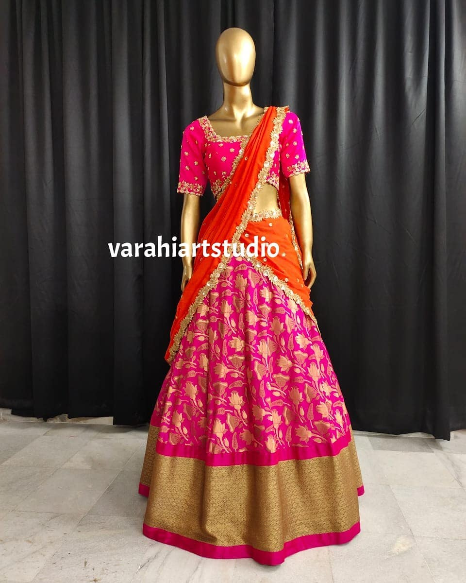Stunning pink color brocade or Benarasi lehenga and blouse with orange color net dupatta. Blouse with hand embroidery work.  2021-06-04