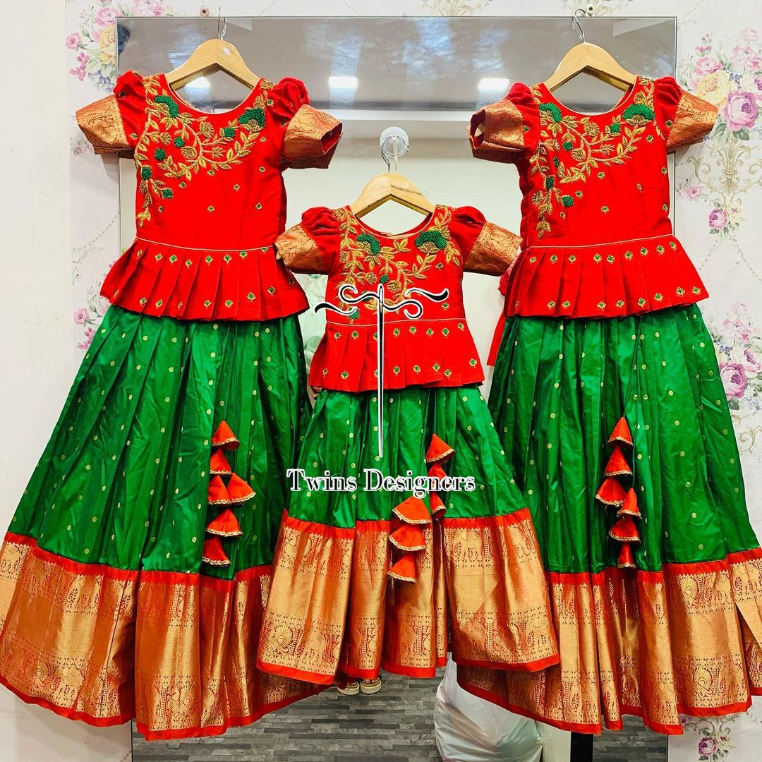 Sisters combo! Stunning traditional parrot green and red color combination kids pattu lehenga and peplum top. Top with hand embroidery work on yoke.  2021-06-04
