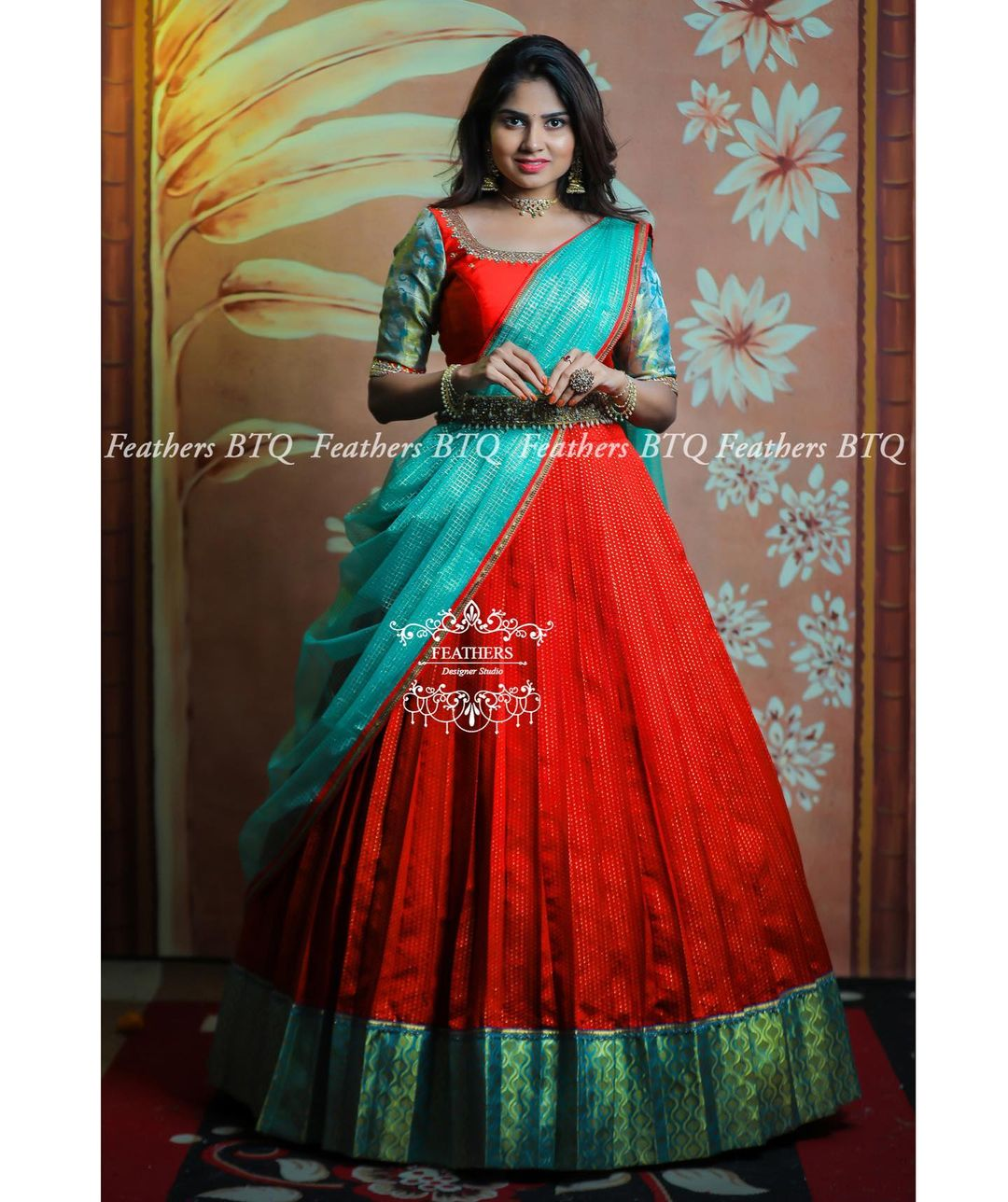 Stunning red and sea green color combination pattu langa and net voni. 2021-06-05