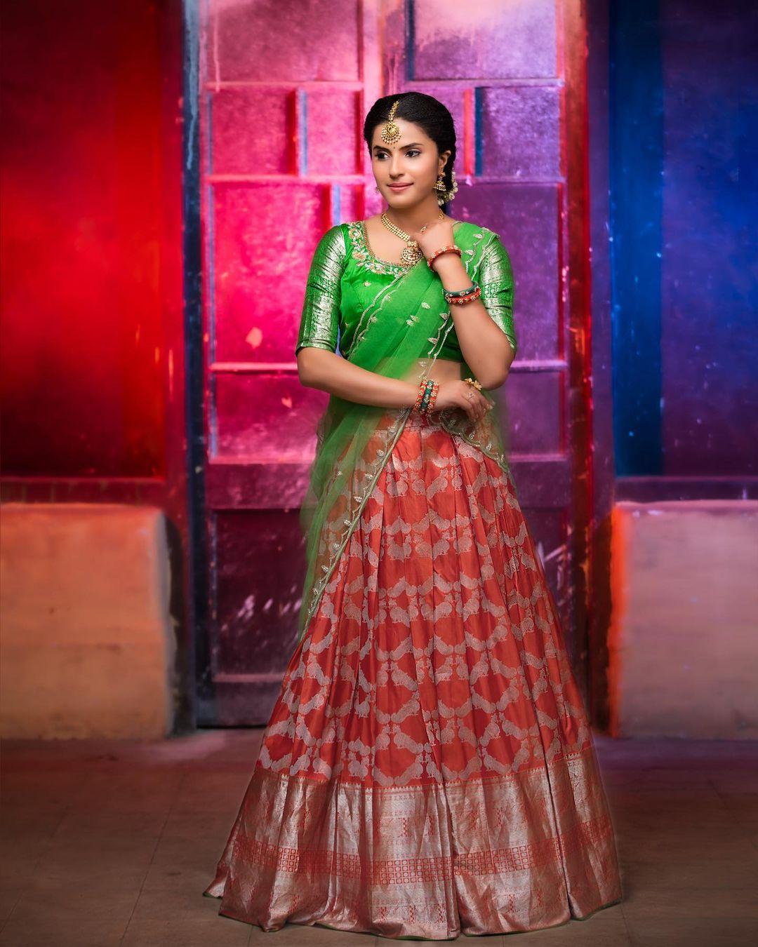 This alluring reddish silver kanjivaram silk has ornate mayil motifs woven across the lustrous body of the drape enhanced by rich silver zari borders.  For enquires - 7995481918/9160560480 2021-06-05
