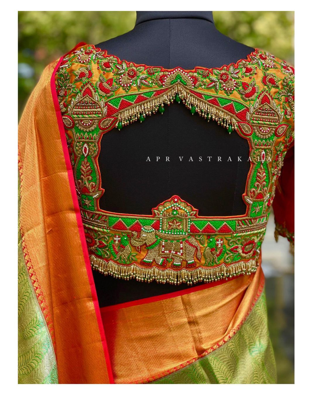 Stunning bridal blouse with floral and elephant hand embroidery maggam work.  2021-06-05