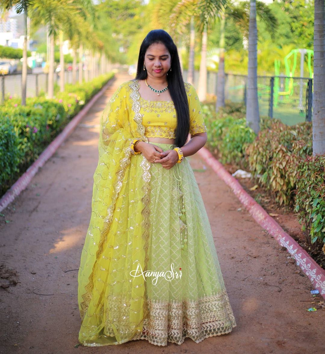 Yellow and Green Pastel. Price : RS. 8600/- Pastel green heavy border netted lehenga paired with beautifully handworked yellow blouse ! 2021-06-06